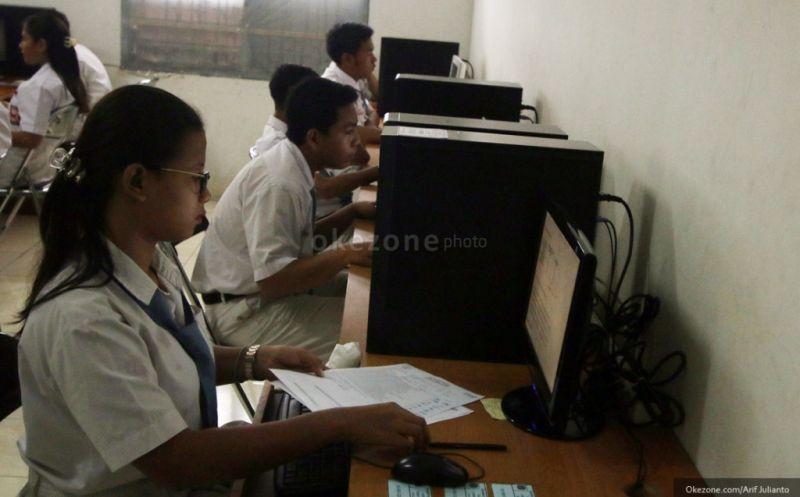 Ilustrasi: suasana ujian nasional berbasis komputer. (Foto: dok. Okezone)