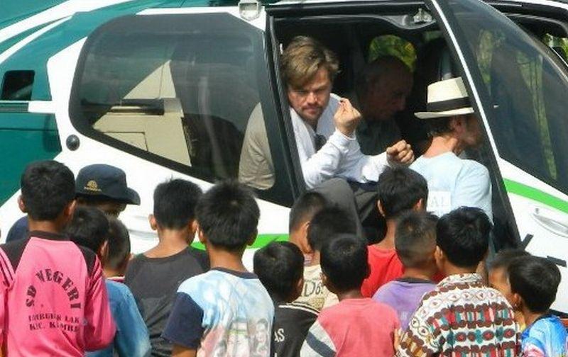 https: img.okezone.com content 2016 03 30 406 1349709 top-travel-2-leonardo-dicaprio-habiskan-2-jam-lihat-orangutan-44qohff3hX.jpg