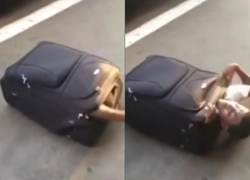 Pemuda Afrika selundupkan diri dalam koper. (Foto: Youtube)