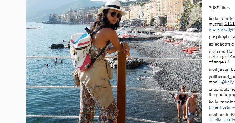 https: img.okezone.com content 2016 07 16 481 1439627 foto-holiday-di-italia-kelly-tandiono-tetap-olahraga-z540Y64Bez.jpg