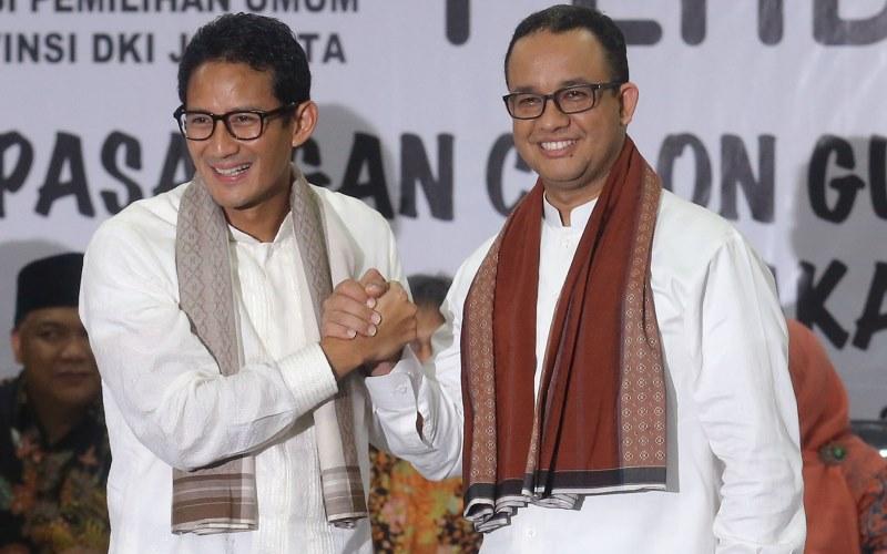 Pasangan Anies Rasyid Baswedan (kanan) & Sandiaga Salahuddin Uno (Foto: SINDO)