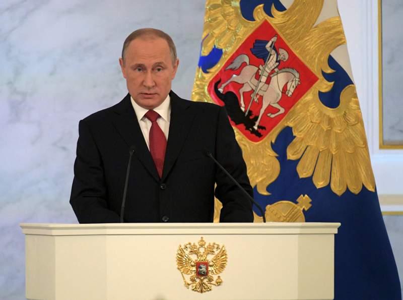 Presiden Rusia Vladimir Putin saat memberikan pidato tahunan di Kremlin (Foto: Alexei Druzhinin/Reuters)