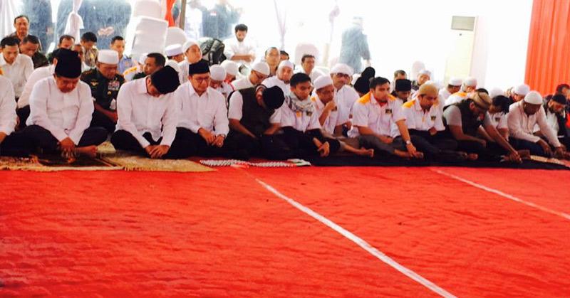 Presiden Joko Widodo menunduk. (Foto: Reni/Okezone)