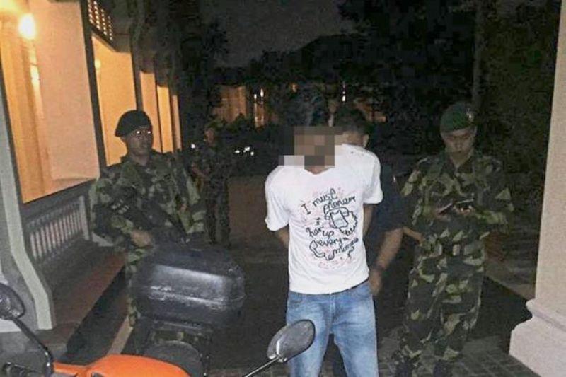 Pemuda ditangkap karena melemparkan bom molotov ke kompleks istana kesultanan Johor. (Foto: The Star)