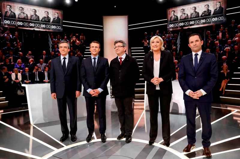 (Francois Fillon, Emmanuel Macron, Jean-Luc Melenchon, Marine Le Pen, dan Benoit Hamon. Foto: Patrick Kovarik/Reuters)