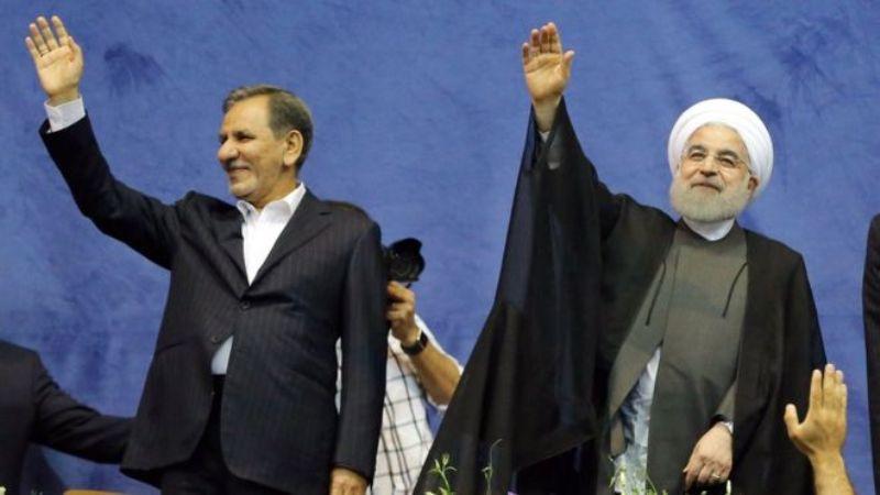 Wakil Presiden Iran Eshaq Jahangiri (ki) bersama Presiden Hassan Rouhani. (Foto: EPA)