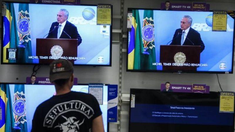 Presiden Brasil Michel Temer berpidato dan menegaskan tidak akan mundur dari jabatannya meski diselidiki atas dugaan kasus korupsi. (Foto: EPA/BBC)