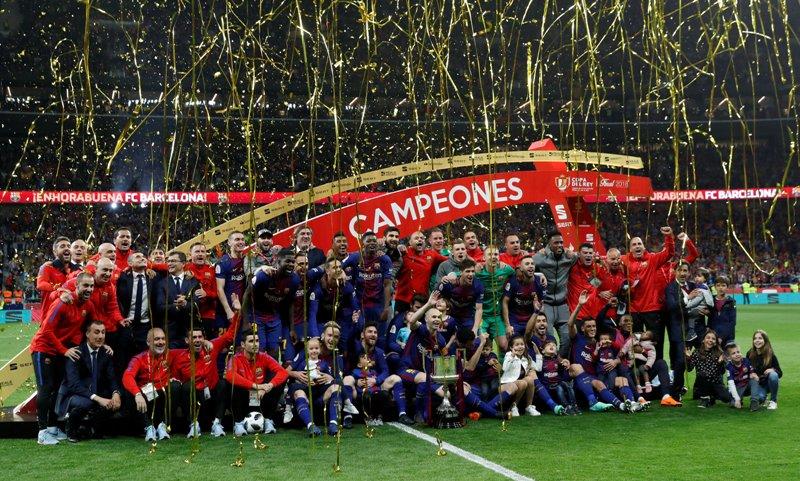 https: img.okezone.com content 2018 04 22 46 1889912 barcelona-pastikan-gelar-copa-del-rey-usai-pesta-gol-melawan-sevilla-KJ2KnvdItN.JPG