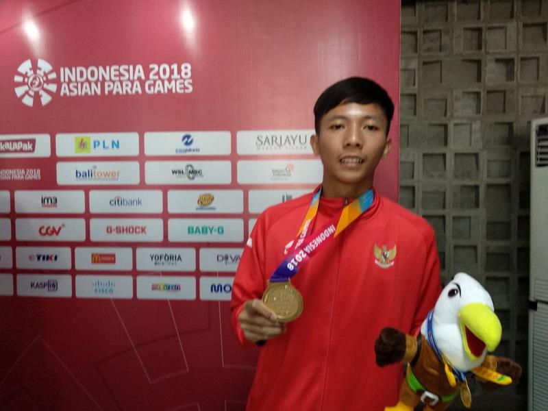 https: img.okezone.com content 2018 10 07 43 1960779 dheva-anrimusthi-sang-penentu-emas-pertama-indonesia-di-asian-para-games-2018-CRH6LKWChC.jpg