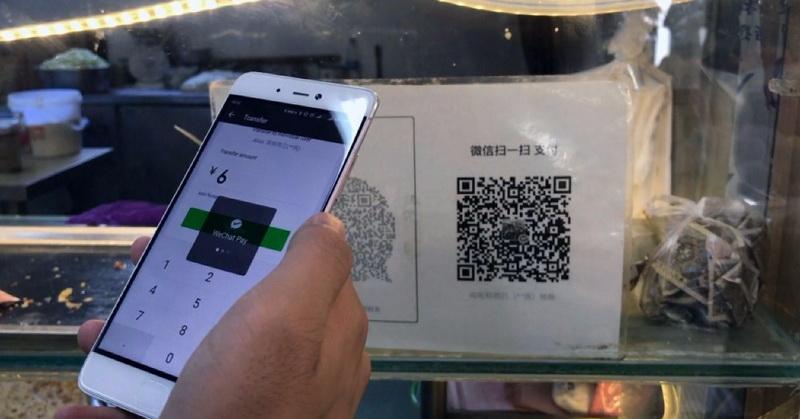 https: img.okezone.com content 2019 04 04 320 2039187 bi-kerja-sama-transaksi-qr-code-dengan-singapura-dan-thailand-78nE8u8QNV.jpg