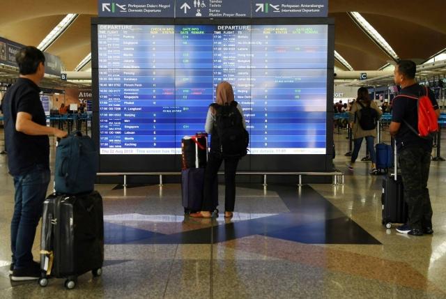 https: img.okezone.com content 2019 08 23 18 2095664 sistem-bandara-kuala-lumpur-bermasalah-penumpang-diminta-tiba-lebih-awal-g9g09Hl4be.jpg