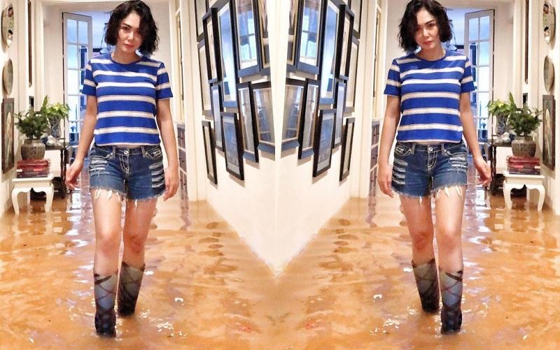 https: img.okezone.com content 2020 01 16 194 2154000 sepatu-boots-yuni-shara-saat-kebanjiran-curi-perhatian-segini-harganya-7LM7BqKf0E.jpg