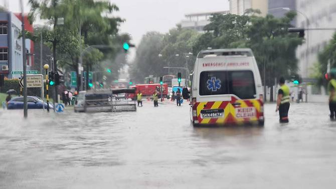 https: img.okezone.com content 2020 06 23 18 2235114 diguyur-hujan-lebat-beberapa-wilayah-di-singapura-dilanda-banjir-i5POlHbBRr.jpg