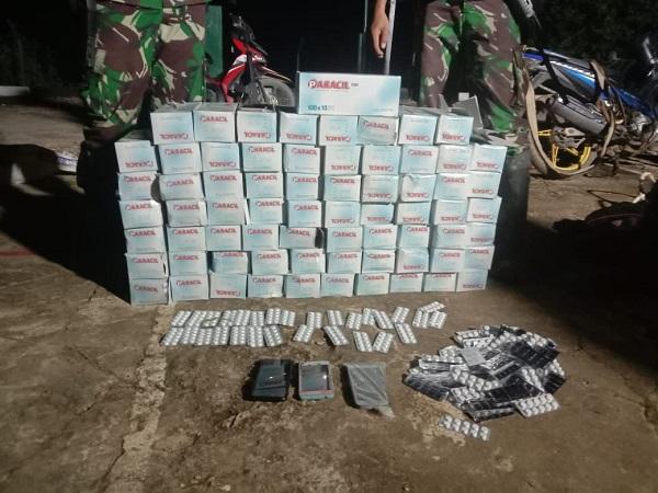 https: img.okezone.com content 2020 09 13 340 2276859 tni-gagalkan-penyelundupan-3-karung-obat-ilegal-di-perbatasan-indonesia-malaysia-eB1ikNvwr7.jpg