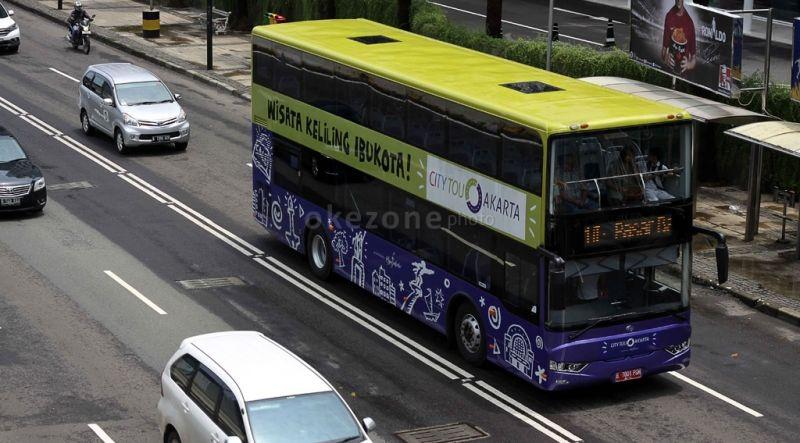 https: img.okezone.com content 2020 10 15 406 2294188 bus-city-tour-jakarta-belum-beroperasi-di-masa-psbb-transisi-QrU8nSVXre.jpg