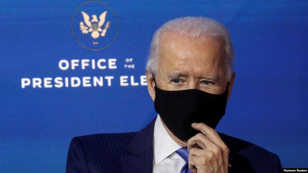 https: img.okezone.com content 2020 12 05 18 2322012 joe-biden-ingin-warga-as-kenakan-masker-setidaknya-selama-100-hari-lAyrUU23en.jpg
