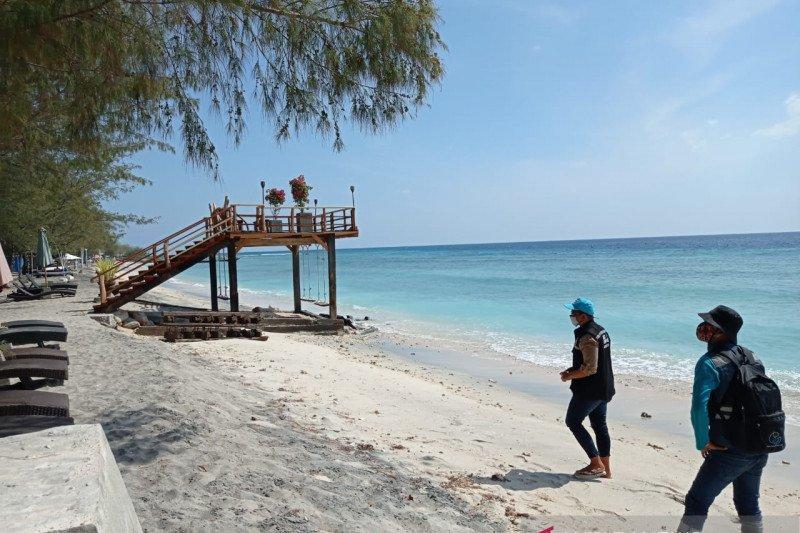 https: img.okezone.com content 2021 02 11 408 2360235 lombok-utara-siapkan-paket-wisata-snorkeling-dan-diving-di-tiga-pulau-t9S6VnC5ZF.jpg