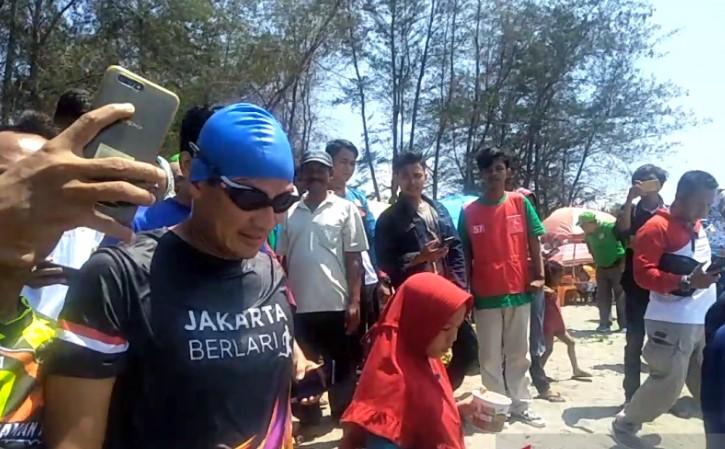 https: img.okezone.com content 2021 02 23 406 2367050 pariaman-triathlon-2021-digelar-agustus-sandiaga-uno-dijadwalkan-hadir-WeHswWIk66.jpg