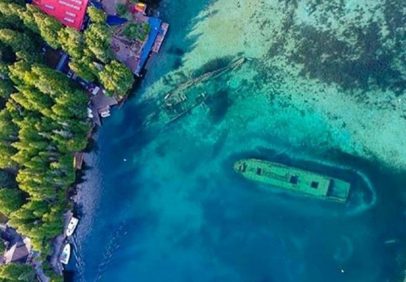 https: img.okezone.com content 2021 03 28 408 2385509 scuba-diving-di-taman-nasional-ini-anda-bisa-lihat-bangkai-kapal-batu-bara-uFvzqruKn7.jpg
