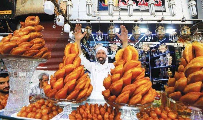 https: img.okezone.com content 2021 05 01 301 2403999 menikmati-roti-khas-ramadhan-yang-tak-hilang-tergerus-perang-di-suriah-i8qvjGOEnV.jpg