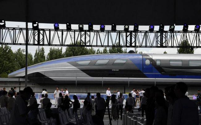 https: img.okezone.com content 2021 07 21 406 2443570 wow-china-punya-kereta-tercepat-di-dunia-bisa-melesat-600-km-jam-VbtWUfabsY.JPG