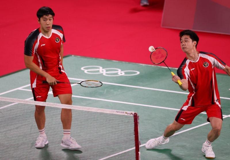 https: img.okezone.com content 2021 07 27 40 2446930 hasil-drawing-perempatfinal-ganda-putra-olimpiade-tokyo-2020-marcus-kevin-lawan-ganda-malaysia-ahsan-hendra-tantang-tuan-rumah-TIOG8Mu4pr.jpg