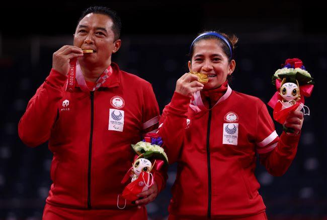 https: img.okezone.com content 2021 09 05 40 2466471 leani-ratri-oktila-atlet-para-badminton-kebanggan-indonesia-yang-sumbangkan-dua-medali-emas-di-paralimpiade-tokyo-2020-9j8NKrtaNR.JPG
