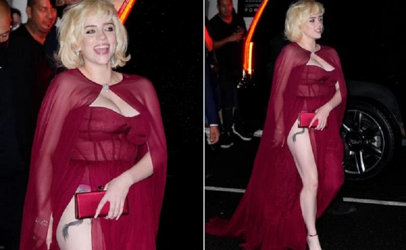 Pakai Gaun Merah Super Seksi, Billie Eilish Pamer Tato di Paha