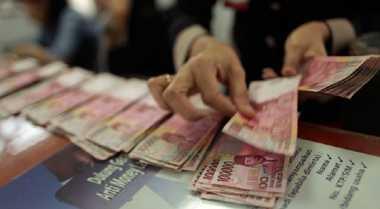 Rupiah Dibuka di Level Rp12.900 per USD