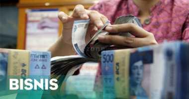 \   Bank Victoria Tunda Bagikan Dividen   \
