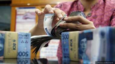 \Sri Mulyani Turunkan Subsidi Bunga KUR dan Pangan di 2017   \