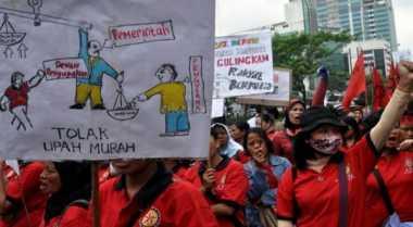 \Tetapkan UMP Berdasarkan PP 78/2015, Buruh Siap Mogok\