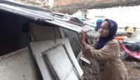 Potret Perempuan Miskin Hidup di Tengah Himpitan Bangunan Mewah