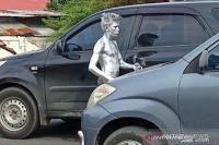 Mengejutkan! Manusia Silver Bisa Raup Rp150 Ribu dalam Satu Jam