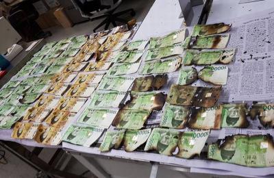 Bank Sentral Imbau Warga Tak Steril Uang di Microwave dan Mesin Cuci
