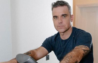 Liburan ke Karibia, Robbie Williams Positif Terpapar COVID-19