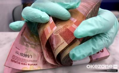Rupiah Ditutup Menguat ke Rp14.223 USD, Investor Pantau Pertemuan The Fed